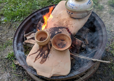 The clay cooking element breaks under the heat of the fire pit